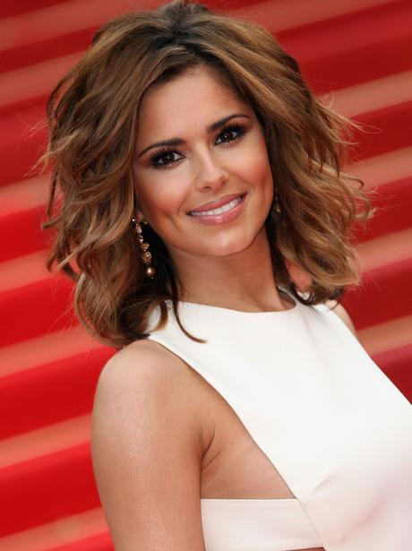 Cheryl Cole smiling on the red carpet.