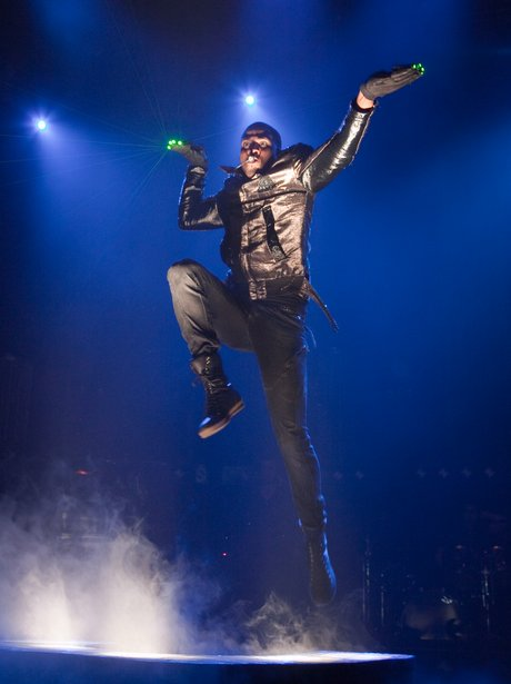 Jason Derulo jumps up on stage during a show