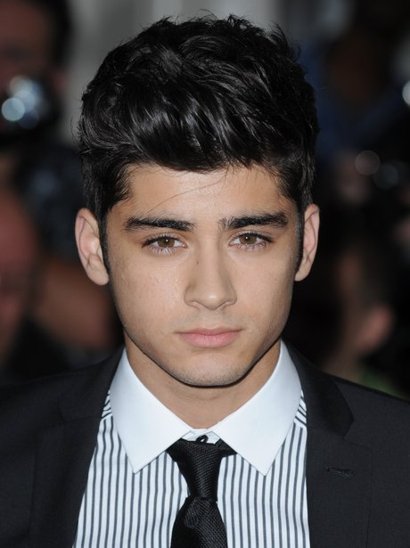 One Direction's Zayn Malik wearing a suit.