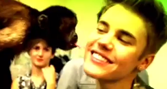 Justin bieber kissed by monkey
