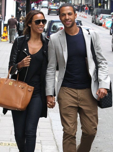 Rochelle Wiseman and Marvin Humes holding hands.