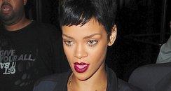 Rihanna wearing a black mini skirt in New York