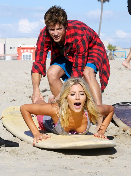 The Saturdays Mollie King on a surfboard