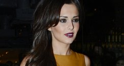 Cheryl Cole wearing a leather dress in London