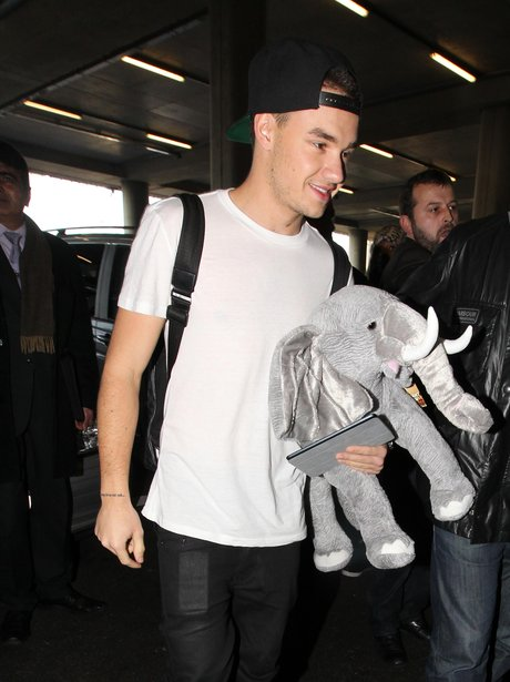 One Direction arrive back in the UK