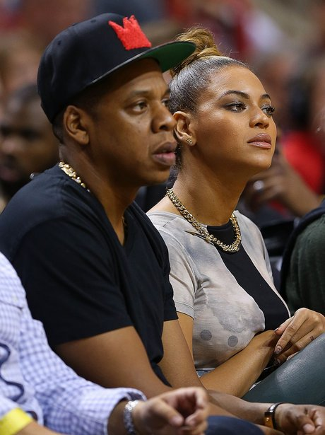 Beyonce and Jay-Z watch a basketball game together