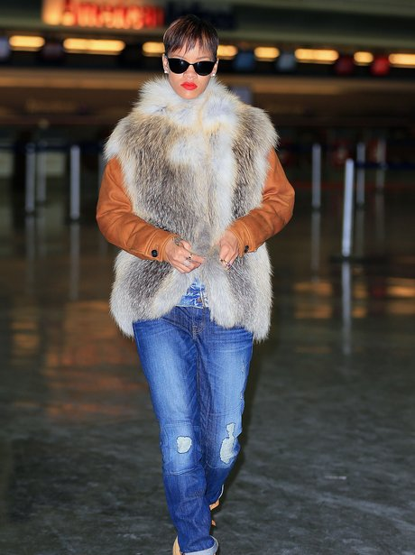 Rihanna weatring a fur gillet at the airport