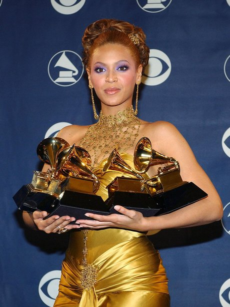 Beyonce collects her awards at the Grammys in 2004