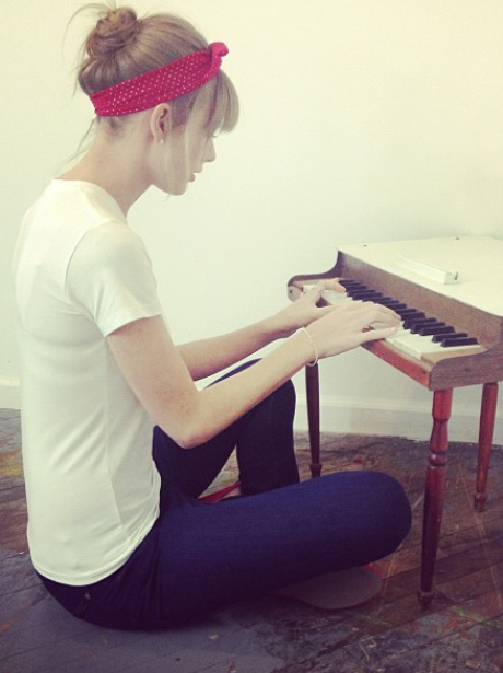Taylor Swift playing a small piano