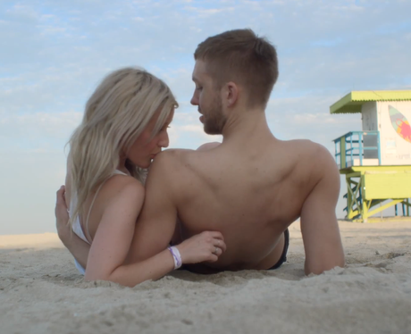 Ellie Goulding kissing Calvin Harris' shoulder