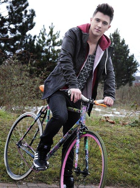 Union J's JJ Hamblett on a bike