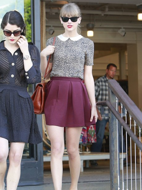 Taylor Swift shopping wearing a maroon skirt
