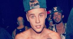Justin Bieber posing topless