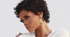 rihanna sizzles in first photoshoot with new short curly