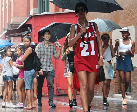Rihanna using an umbrealla in the rain