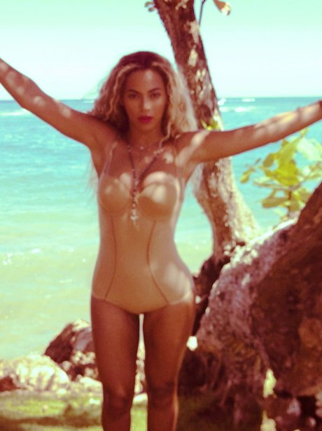 Beyonce wearing a swimming costume