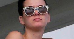 Katy Perry wearing a bikini on her balcony