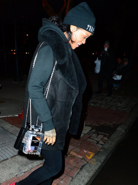 Rihanna carrying her chanel perfume bottle purse
