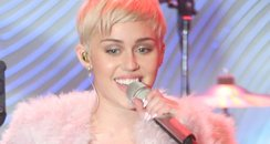 miley cyrus performing on stage