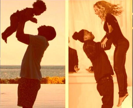 Jay-Z lifts up Beyonce into the air