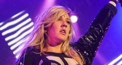 Ellie Goulding wearing a bodysuit on stage