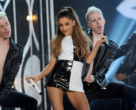 Ariana Grande performs and wearing monochrome.