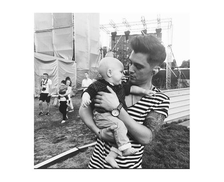 JJ from Union J with his son Preston at festival.