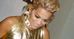 Rita Ora wearing a gold outfit