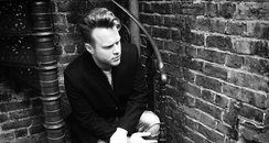 Olly Murs sitting on stairs