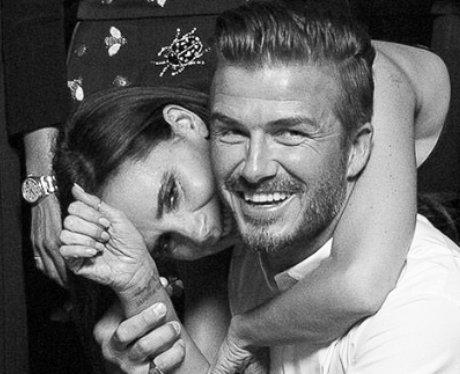 David and Victoria Beckham hug