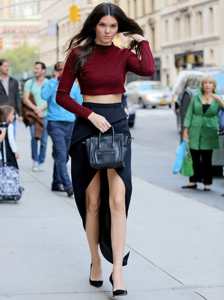 Kendall wears a red top in new York