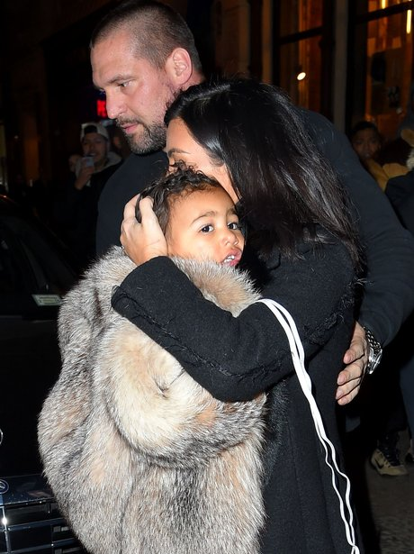 North West wearing a fur coat