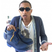 Image 4: Pharrell Williams holding trainers