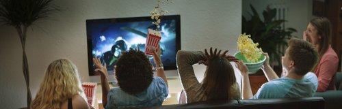Friends watching nighttime tv