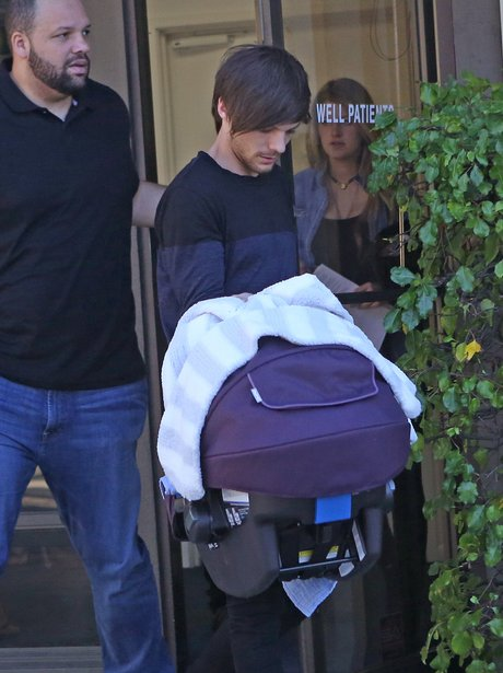 Louis Tomlinson and Briana with baby Freddie