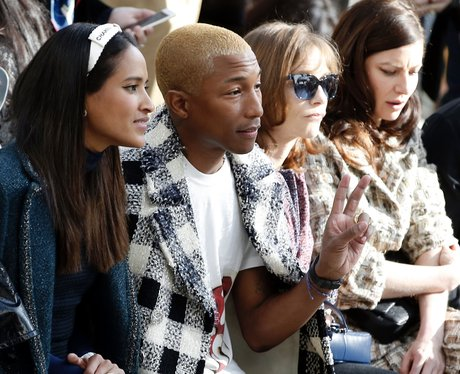 Pharrell Williams and wife FROW during Paris Fashi