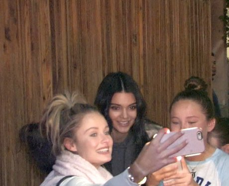 Kendall Jenner poses for selfies with fans