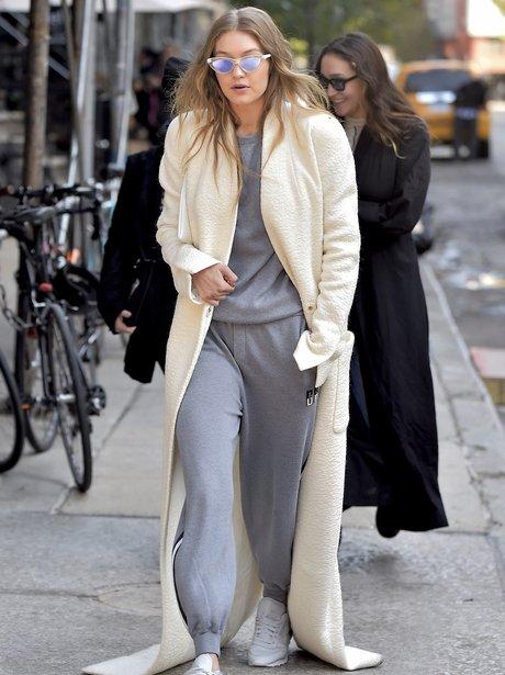 Gigi Hadid's coat is so long that it sweeps the ro