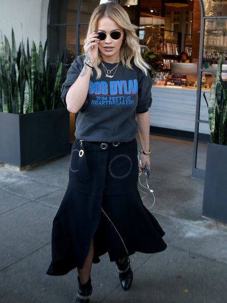 Rita Ora rocks an edgy t-shirt whilst out and abou